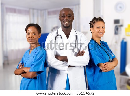 group of african american doctor and nurse in hospital ward - stock photo