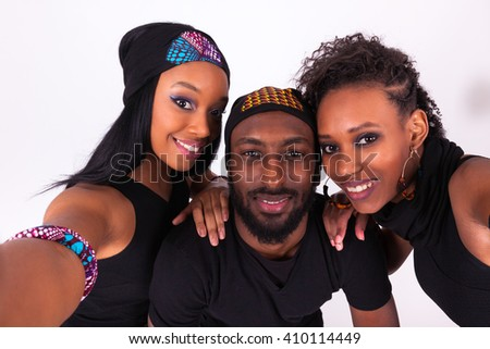 Group of African American friends taking a selfie portrait isolated over a gray background