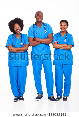 group of african medical professionals full length portrait on white - stock photo
