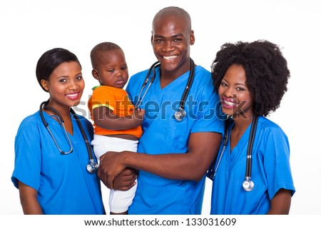 group of african pediatricians with baby boy isolated on white - stock photo