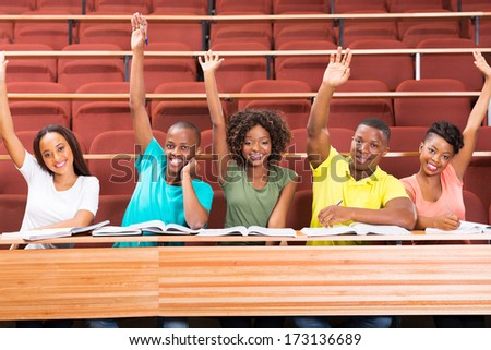 group of african uni students arms up in classroom