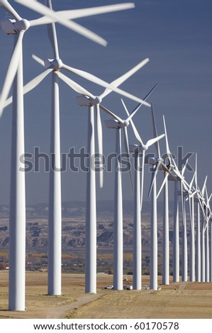 group of aligned windmills - stock photo