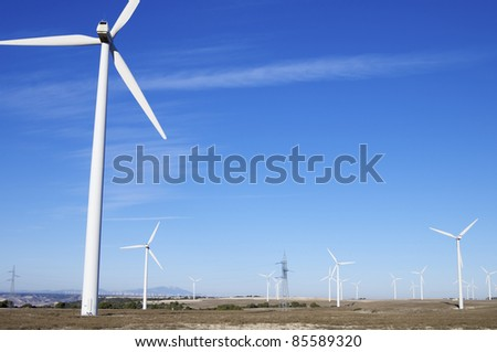 group of aligned windmills for electric power generation alternative