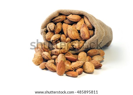 Group of Almond in shell and shelled in burlap sack isolated on white background ,nut, vegetarians food.