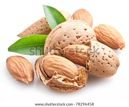 Group of almond nuts with leaves. Isolated on a white background. - stock photo
