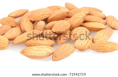 group of almonds isolated on the white background - stock photo
