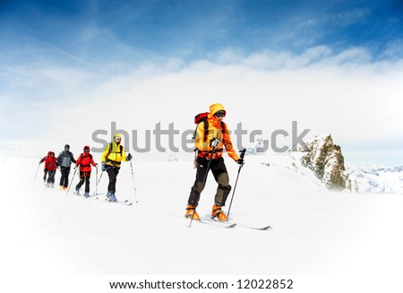 Group of alpine touring skiers on the big Verra Glacier; in background the Matterhorn, Swiss-Italy border. - stock photo