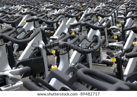 Group of aluminum spinning bikes outdoors - stock photo