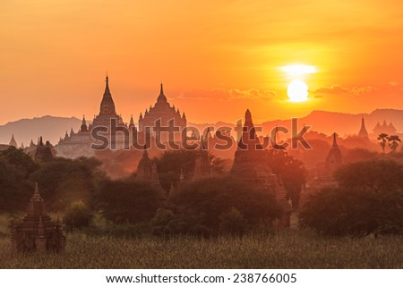 group of ancient pagodas in Bagan at the sun set, myanmar - stock photo