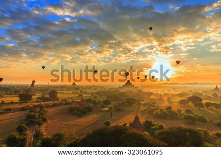 group of ancient pagodas in Bagan with altitude balloons at the sunrise, bagan, myanmar - stock photo
