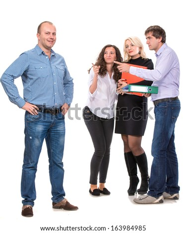 Group of angry business people with businessman leader on foreground.Focus on the man who is ahead - stock photo
