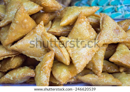 group of arab pastries with honey at a street vendor - stock photo