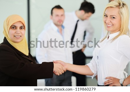Group of Arabic business people handshaking for a deal - stock photo
