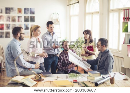 Group Of Architects Having Meeting - stock photo