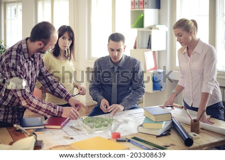 Group Of Architects Having Meeting