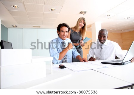 Group of architects working in the office - stock photo