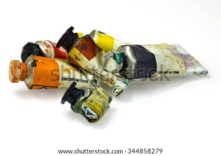 Group of artists paint tubes; used tubes of oil paints, isolated on white ground; differential focus  - stock photo