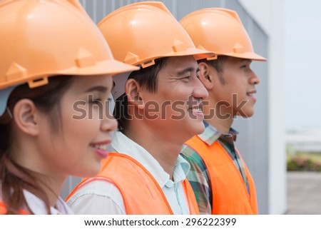 Group of Asian architects standing in a row, focus on contractor - stock photo