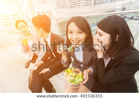 group of Asian business team having lunch in the outdoor - stock photo