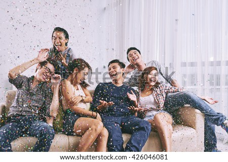 Group of Asian friends having fun at home party - stock photo