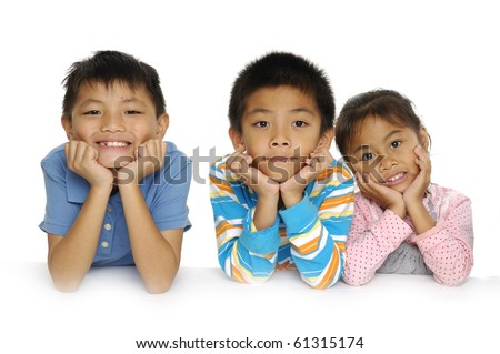 Group of asian happy children lying on floor, wearing colorful, striped pullover and t-shirt, smiling - stock photo