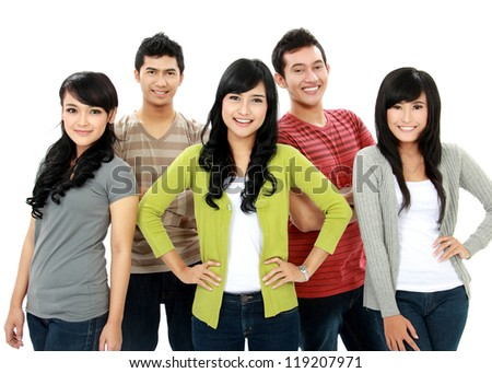 group of asian smiling friends staying together and looking at camera