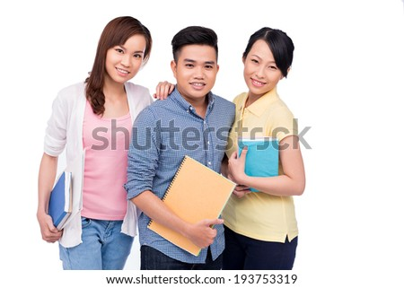 Group of Asian students with notebooks - stock photo