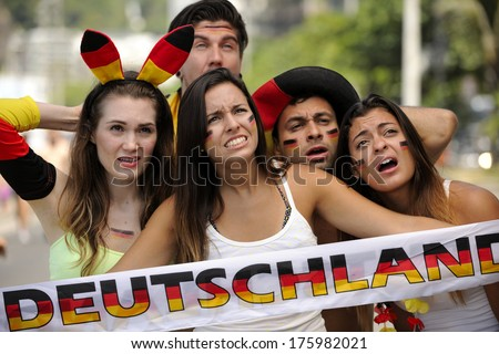 Group of astonished German sport soccer fans. - stock photo