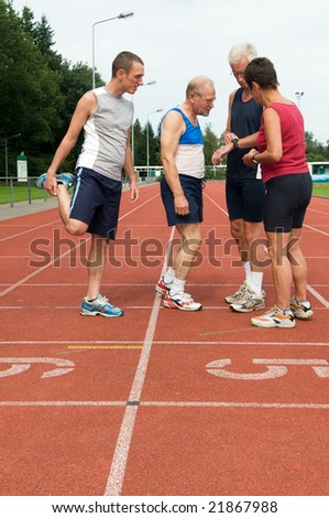 Group of athletes discussing their just finished run
