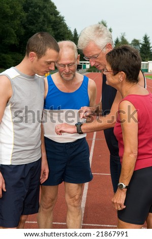 Group of athletes discussing their just finished run - stock photo