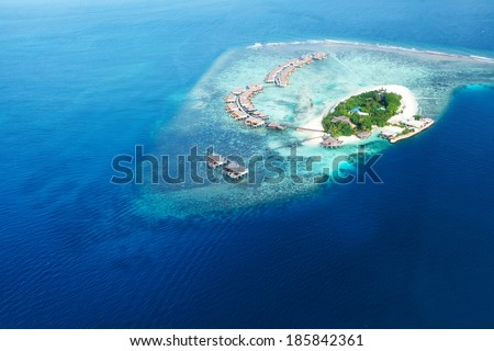 Group of atolls and islands in Maldives from aerial view - stock photo