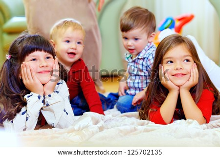 group of attentive kids in nursery room - stock photo