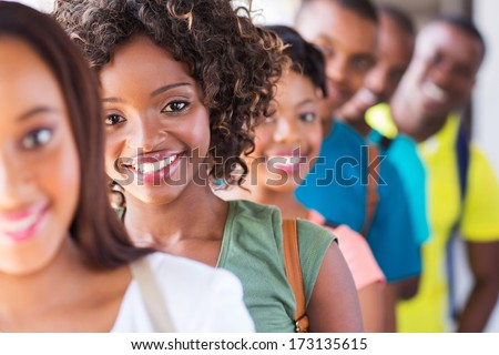 group of attractive african american college students on campus - stock photo