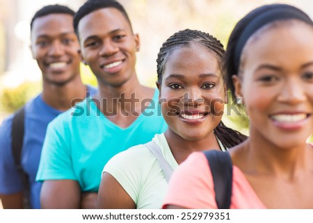 group of attractive african american college students outside on campus