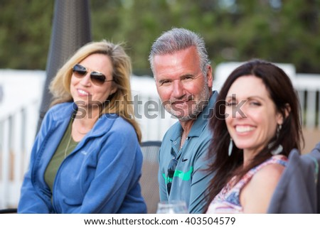 Group of attractive middle-aged friends outside - stock photo