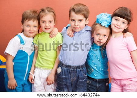Group of attractive preschool kids embracing - stock photo