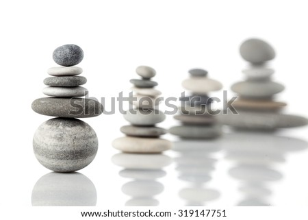 Group of balanced piles of different river stones - stock photo