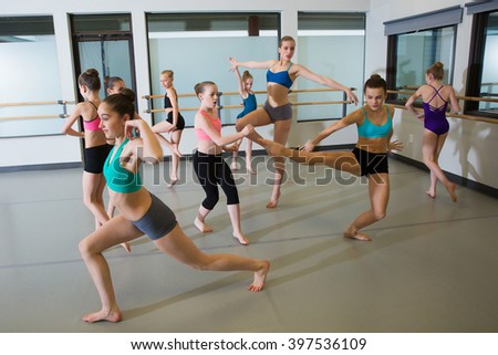 Group of ballet dancers having fun in studio