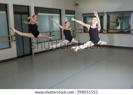 Group of ballet dancers jumping in the air