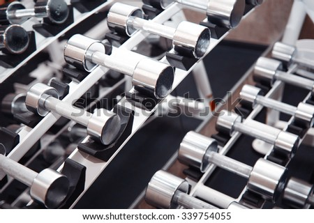 Group of barbells arranged in row at the gym. Horizontal photo - stock photo