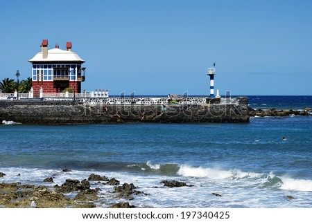 Group of bathers on the coast of Arrieta. Lanzarote, Spain. - stock photo