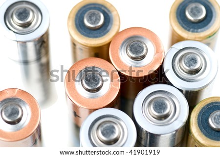 Group of batteries isolated on white with shallow depth of field