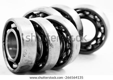 Group of bearings isolated on white background, Black and white photo. - stock photo
