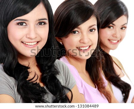 Group of beautiful asian women smiling isolated over a white background
