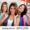 Group of beautiful female shoppers at the mall - stock photo