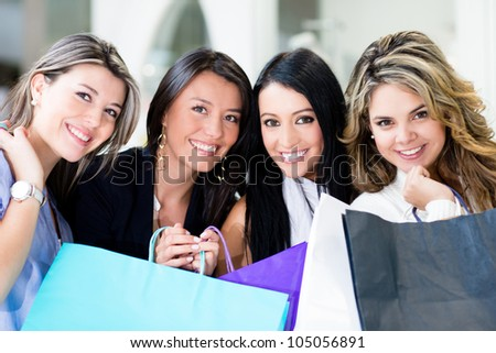 Group of beautiful female shoppers looking happy