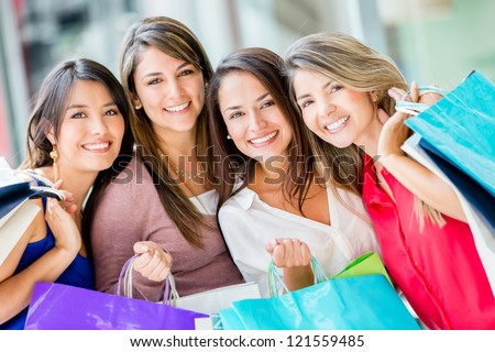 Group of beautiful female shoppers looking very happy - stock photo