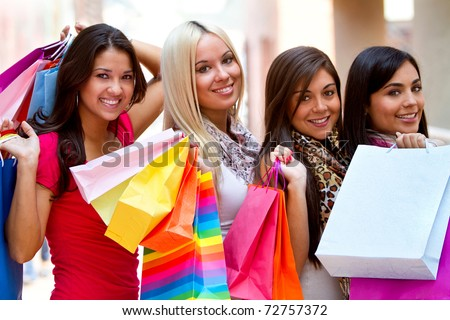 Group of beautiful shopping women with bags and smiling - stock photo