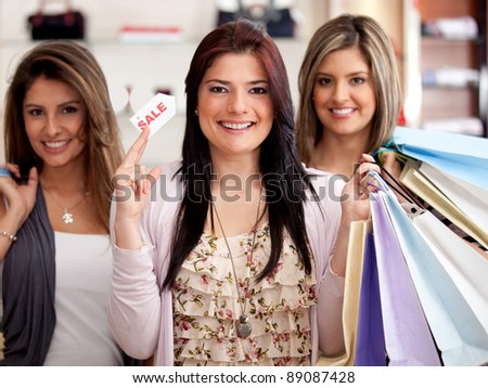 Group of beautiful women at the mall shopping on sale