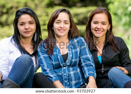 Group of beautiful women relaxing at the park